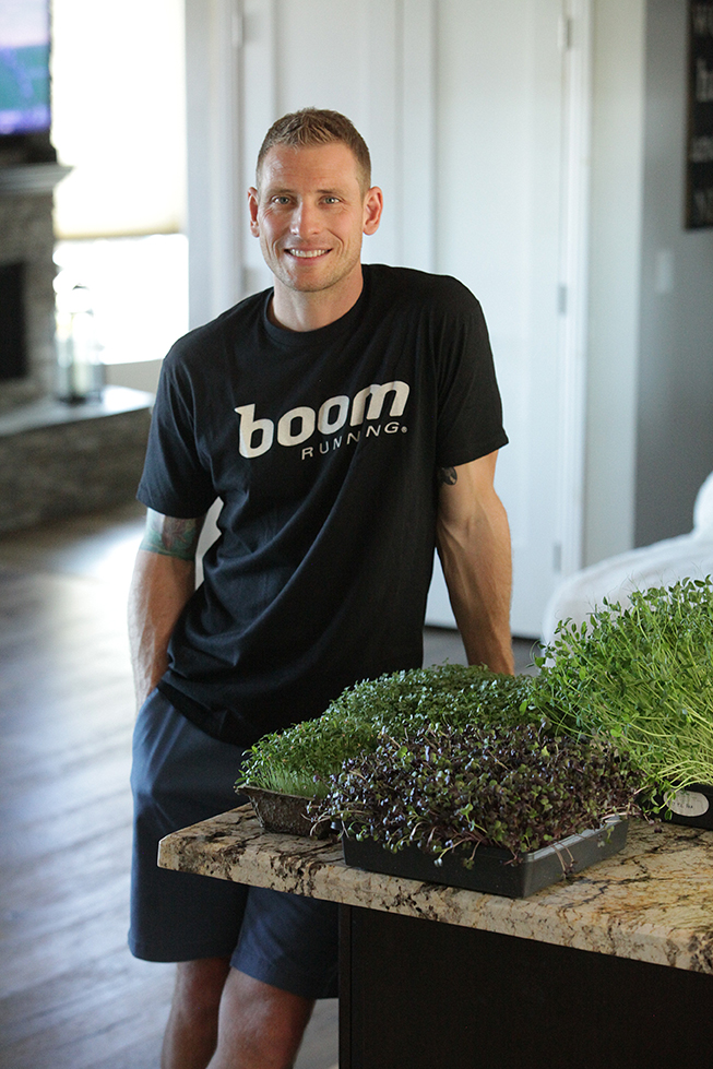 Brian Ciuchta with some of his microgreens. If you eat food like this, you might feel like running a hundred miles too. High Ranch Farm San Diego