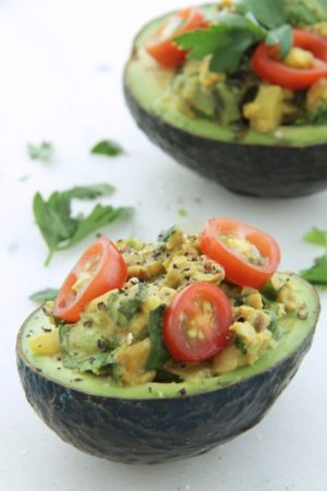 Cheezy Tempeh Stuffed Avocados